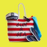 Red stripe beach bag and other accessories Royalty Free Stock Photography