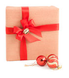 Red stripe paper wrap gift box ribbon bow jingle bell decoration isolated Stock Photos