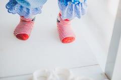 Red striped baby socks Stock Photo