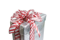 Red striped bow. Wrapped present with a red and white striped bow Stock Photo