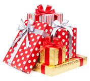 Red and striped and gold boxes with gifts tied bows on white bac Stock Image