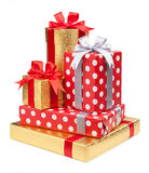 Red and striped and gold boxes with gifts tied bows on white Royalty Free Stock Photos