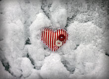 Red striped heart on snow background Stock Images