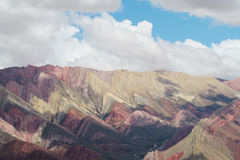 Red striped mountains Cerro de siete colores in Argentina Royalty Free Stock Image