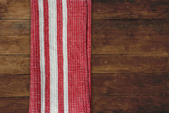Red striped napkin on wood Stock Photo