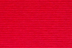 Red striped paper texture as background. Stock Image