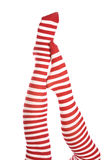 Red striped socks one foot on other Royalty Free Stock Photos