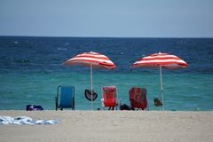 Red striped umbrellas on Dania Beach, in Fort Lauderdale, Florida Stock Images