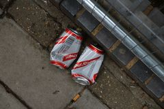 Red stripes beer cans after party morning stock photo
