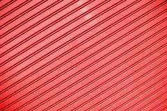 Red stripes Metal sheet wall texture background Stock Photos