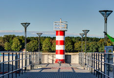 Red stripped beacon. The old crossing from Klaipeda to the Curonian spit. Stock Images