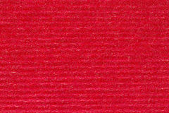 Red stripped paper background, close up. Stock Images