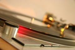 Red strobe light on a silver DJ turntable Royalty Free Stock Photos