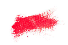 Red stroke of the paint brush. On white paper royalty free stock image