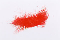 Red stroke of the paint brush. On white paper stock image