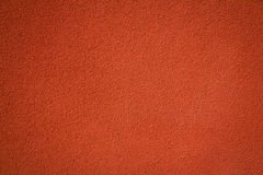 Red stucco textured concrete wall background Royalty Free Stock Photography