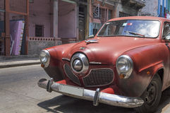 Red Studebaker in Havana, Cuba. Front view of a red Studebaker running every day in Havana, Cuba royalty free stock photography