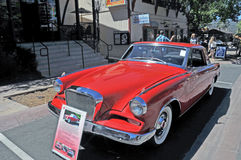 Red Studebaker. This is a rare 1942 Studebaker Gran Turismo complete with original whels and hubcaps Stock Image