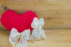 Red stuffed heart and silk ribbons Stock Photo