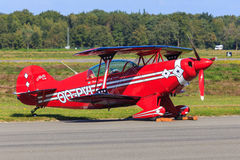 Red stunt plane Stock Photos