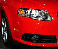 Red style. Closeup of the front corner of a red sports car Royalty Free Stock Images