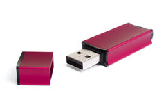 Red stylish flash drive. With the cover removed on a white background Royalty Free Stock Photography