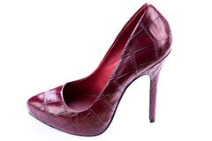 Red stylish leather high heels isolated on white. Red stylish leather high heels shoes stilettos isolated on white background stock photos