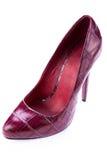 Red stylish leather high heels isolated on white. Red stylish leather high heels shoes stilettos isolated on white background stock photo