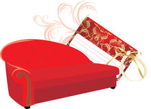 Red stylish sofa with gift card Royalty Free Stock Image
