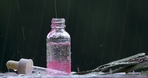 Red substance dripping in glass bottle