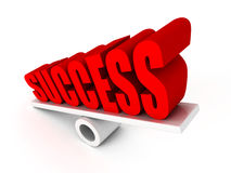Red SUCCESS word on balance Royalty Free Stock Image