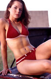 Red suede bikini portraits. Stock Photo