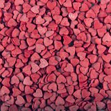 Red sugar hearts background Stock Image