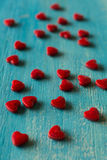Red sugar hearts background Royalty Free Stock Photos