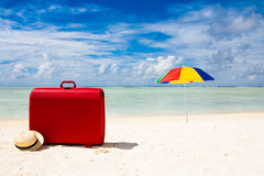 Red suitcase at the beach Stock Image