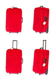 Red suitcase with blank tag over white. Set. Red suitcase with blank identification tag over white. Set of four suitcases in different angle view Royalty Free Stock Photo