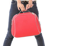 red suitcase carried by a slim girl Stock Photo