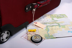 Red suitcase with map Stock Photography