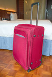 Red suitcase stands up Stock Photography