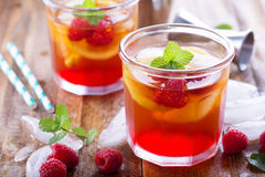 Red summer cocktail with lemons and raspberry Stock Photography