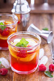 Red summer cocktail with lemons and raspberry Stock Image