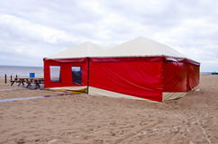 Red summer resort cafe tent on sea beach Royalty Free Stock Image