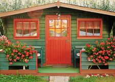Red summerhouse Stock Photos