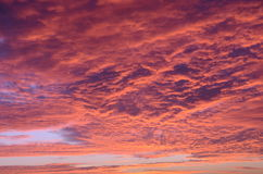 Red sun against clouds. Scottish sunset making clouds red and orange royalty free stock photo