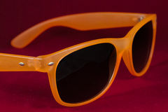 Red sun glasses. Isolated over the red background Stock Images