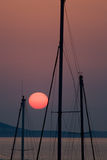 Red Sun and masts Stock Image