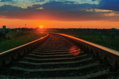 Red sun on sunset over railway Royalty Free Stock Photos