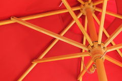 Red Sun Umbrella. Looking up under a red sun umbrella royalty free stock photography