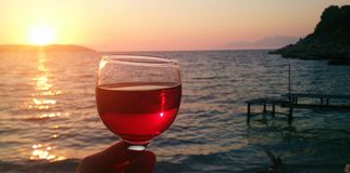Red sune, red wine. Stock Photography