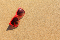 Red sunglasses on the beach Stock Photography